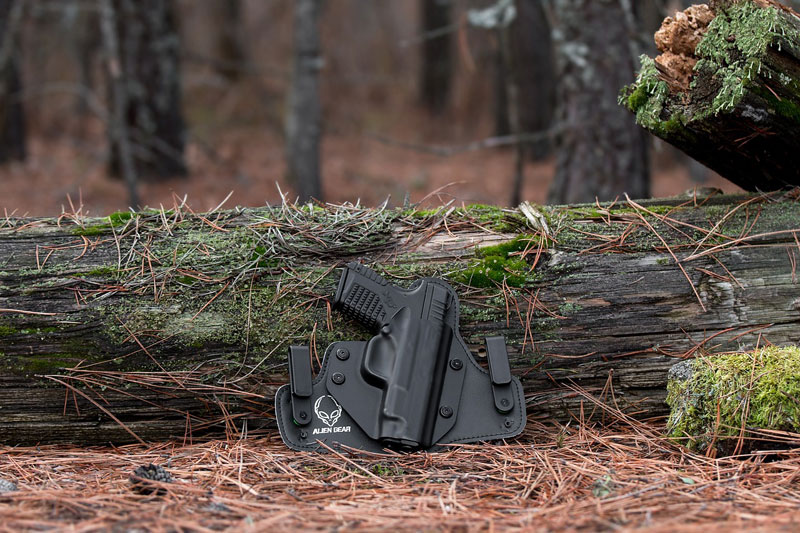 gun in a holster in the woods