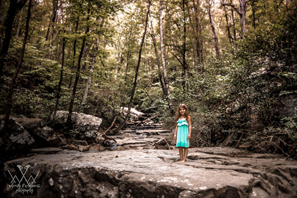 little girl standing on dry creek bed at glen falls chattanooga