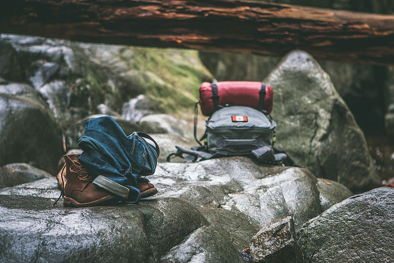packed backpacks on a rock