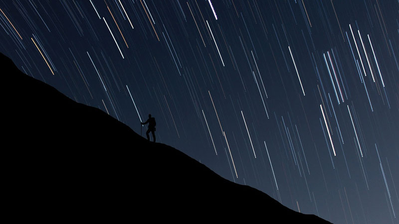 figure of a man hiking at night
