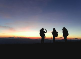 hikers at sunset