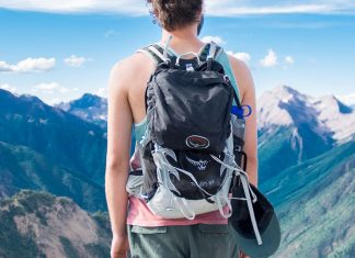 guy overlooking vaklley wearing osprey backpack